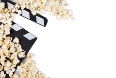 Black with white letters clapper film, lot popcorn isolated on w. Black with white letters clapper film, a lot of popcorn isolated on white background royalty free stock photography