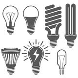 Black and white light bulb icons set. Royalty Free Stock Images