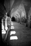 Black and white light shines through arched window in the exterior hallway of the Abbaye de Fontenay, Burgundy, France Stock Photos