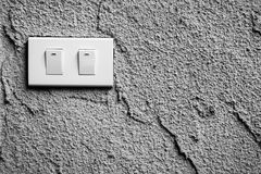 Black and white of light switch on wall Royalty Free Stock Images