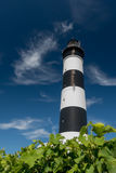 Black and white lighthouse  on a blue sky Stock Photo