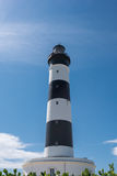 Black and white lighthouse isolated on a blue sky Royalty Free Stock Images
