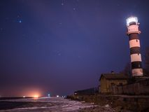 Black and white lighthouse at night in Baltic sea beach Stock Photography