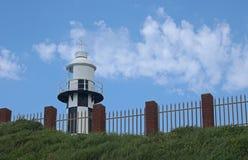 Black and white lighthouse at Port Shepstone, Kwazulu Natal. Black and white lighthouse against blue sky at Port Shepstone, Kwazulu Natal Stock Photos
