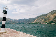 Black and white lighthouse in the sea. Prcanj, Kotor Bay, Monten Stock Photography