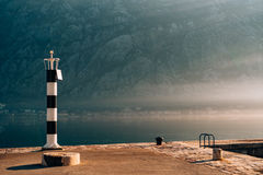 Black and white lighthouse in the sea. Prcanj, Kotor Bay, Monten Stock Photos
