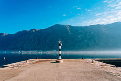 Black and white lighthouse in the sea. Prcanj, Kotor Bay, Monten Stock Images