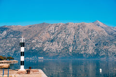 Black and white lighthouse in the sea. Prcanj, Kotor Bay, Monten Royalty Free Stock Photos