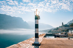 Black and white lighthouse in the sea. Prcanj, Kotor Bay, Monten Royalty Free Stock Photo