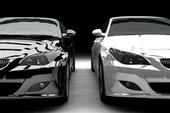 Black and white limousines. A black and a white limousine isolated Stock Photography