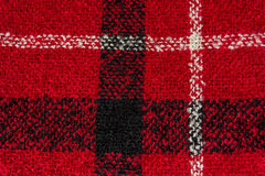 Black and white lines on red textured woolen background Royalty Free Stock Photos