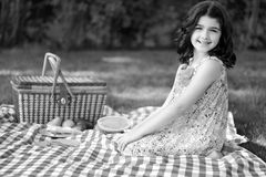 Black and white little girl vintage picnic Royalty Free Stock Photos