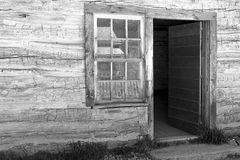 Black and White log cabin Stock Image