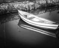 Lonely small boat stock photos