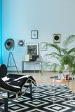 Black and white lounge area design. In modern loft stock photos