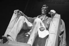 Black and white low-angle shot of Abraham Lincoln memorial in Washington DC. Black and white low-angle shot of Abraham Lincoln statue in the memorial building royalty free stock images