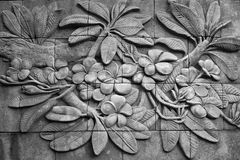 Black and white of low relief cement Thai style handcraft of plu Royalty Free Stock Image