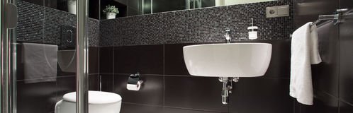 Black and white luxurious bathroom. View of black and white luxurious bathroom stock images