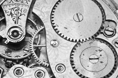 Black and white macro photo close-up view of metal clockwork Stock Photography