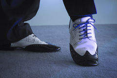 Black and white male dancing shoes with blue ribbon. Dancing shoes feet of male ballroom, latin, salsa and swing dancer Royalty Free Stock Photography