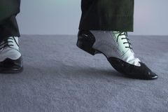 Black and white male dancing shoes. Dancing shoes feet of male ballroom, latin, salsa and swing dancer Royalty Free Stock Photography