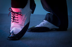 Black and white male dancing shoes. Dancing shoes feet of male ballroom, latin, salsa and swing dancer Royalty Free Stock Photos