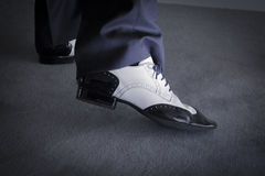 Black and white male dancing shoes. Dancing shoes feet of male ballroom, latin, salsa and swing dancer Royalty Free Stock Image
