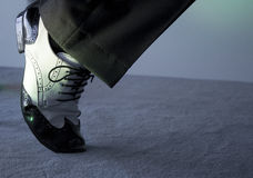 Black and white male dancing shoes. Dancing shoes feet of male ballroom, latin, salsa and swing dancer Royalty Free Stock Photo