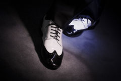 Black and white male dancing shoes. Dancing shoes feet of male ballroom, latin, salsa and swing dancer Royalty Free Stock Images