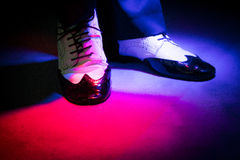 Black and white male dancing shoes. Dancing shoes feet of male ballroom, latin, salsa and swing dancer Stock Photo