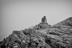 Black and white of man in the cloud on Striding Edge, Helvellyn, Lake District, England, UK stock photos