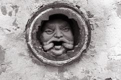 Black and white Man`s face in hole at brick wall in Melbourne. Street Art in Australia Royalty Free Stock Image