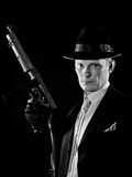 Black and white man's portraite. Man like a chicago gangster with Thompson submachine gun Royalty Free Stock Photography