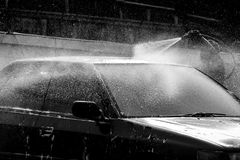 Black and white of man washing car Royalty Free Stock Image