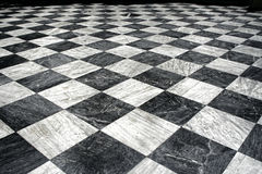 Black and white marble floor. Black and white chequered marble floor pattern stock photo