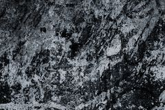 Black and white marble surface, texture. Abstract background, pattern. Dark tile close-up, great design. Old dirty stone wall. Gru. Nge gray granite slab stock photography