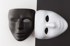 Black and white masks at different angles. Black and white masks without expression at different angles Stock Photos