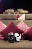 Black and white masks are on soft couch Stock Photos