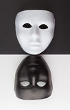 Black and white masks upside down. Personality change concept. Royalty Free Stock Images