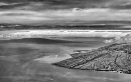 Black and White Maui and Lanai. Black and white image Maui and Lanai from plane with clouds ocean and coastline Royalty Free Stock Image