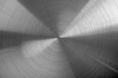 Black and white metal background with circular brushed texture. Scratched round metal plate texture, close-up Stock Photos