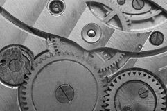 Black-and-white Metal Cogwheels in Clockwork. Stock Photography