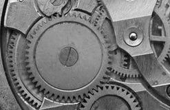 Black-and-white Metal Cogwheels in Clockwork. Macro Stock Images