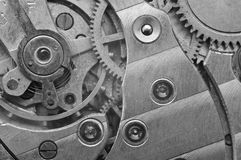 Black-and-white Metal Cogwheels in Clockwork. Macro Royalty Free Stock Photography