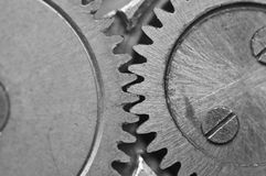 Black-and-white Metal Cogwheels in Clockwork. Macro Stock Photo