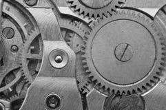 Black-and-white Metal Cogwheels in Clockwork. Macro Stock Photos