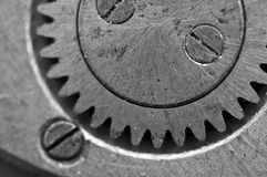 Black-and-white Metal Cogwheels in Oldest Clockwork, Macro. Royalty Free Stock Photography