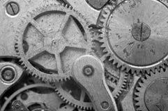 Black-and-white Metal Cogwheels in Oldest Clockwork, Macro. Stock Photos
