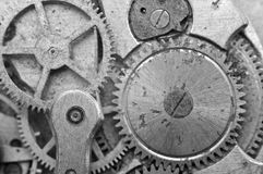 Black-and-white Metal Cogwheels in Oldest Clockwork, Macro. Stock Photography