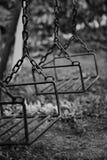 Swing. Black and white metal swing Royalty Free Stock Photo